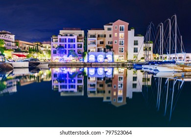 TIVAT, MONTENEGRO - SEPTEMBER 21: Night view of architecture and boats in the famous port of Tivat on September 21, 2016 in Tivat