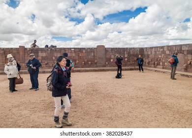 TIWANAKU, BOLIVIA - APRIL 24, 2015: Tourists visit Tiwanaku (Tiahuanaco), Pre-Columbian archaeological site, Bolivia