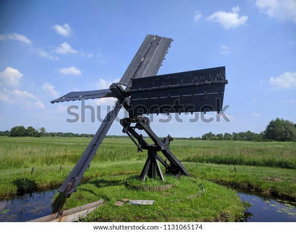 Tjasker, a small type of windmill used solely for drainage purposes. Peat landscape WIEDEN-WEERRIBBEN NATIONAL PARK, OVERIJSSEL