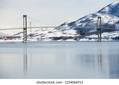 The Tjeldsund suspension road Bridge in winter crossing the Tjeldsundet strait, Troms county, Norway. It is part of a network of bridges that connect islands of Vesteralen and Lofoten to the mainland.