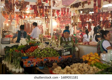Tlacolula, Oaxaca, Mexico, March 2020: Meat and vegetable vendors at the Sunday market.