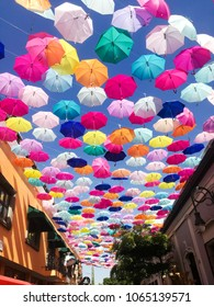 Tlaquepaque, Jalisco / Mexico - April 3 2018: Many umbrellas hang over a main street of the municipality. Decorations like this are common during the year in this town to bring tourism.