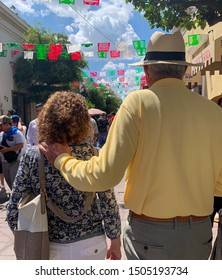 Tlaquepaque, Jalisco, Mexico - September 15 2019: Male and female senior couple walk on the streets of Tlaquepaque. Tall senior man