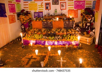 TLAXCALA, MEXICO - NOVEMBER 1 Night scene of a colorful traditional mexican altar during the annual contest of altars, as part of the celebration of the Day of the dead in Tlaxcala, Mexico November