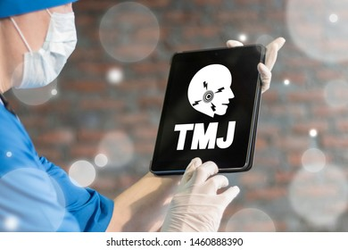 TMJ disease health care concept on laptop's display in doctor's hand. Temporomandibular Joint and Muscle Disorder.