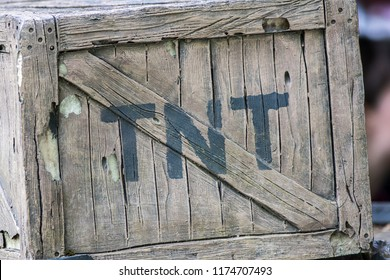 TNT. Box of dynamite. Wild West cowboy mining explosive in wooden crate painted with the letters T N T. Vintage mock-up representing comic-book action and adventure.