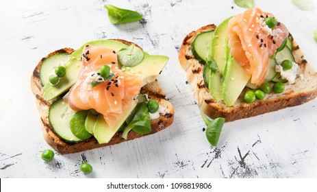 Toast with avocado, cucumber and  salmon. Healthy  eating