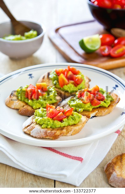 Toast baguette with avocado and tomato