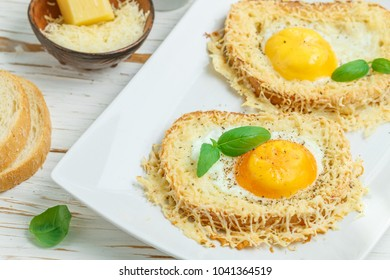 Toast with baked egg, cheese, spices and Basil. Breakfast. Selective focus