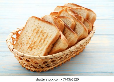 Toast bread in basket on blue wooden table