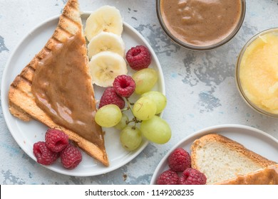 Toast bread with homemade strawberry jam and peanut butter served with berry