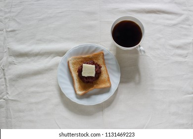 toast bread with red bean paste, butter and black coffee.
