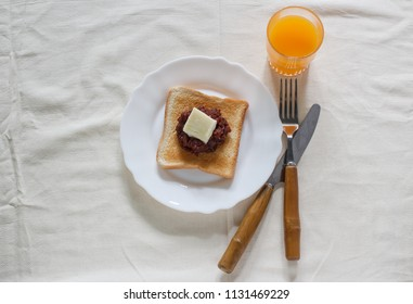 toast bread with red bean paste, butter and fresh orange juice.