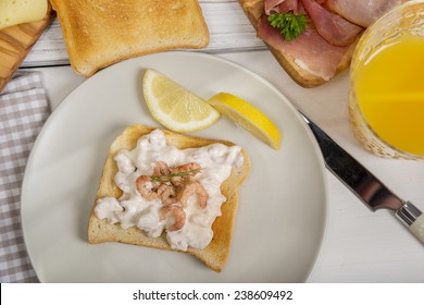 Toast bread with shrimp salad with lemon on plate