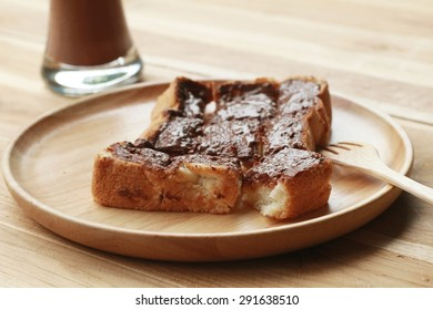 Toast bread topped with chocolate and butter.
