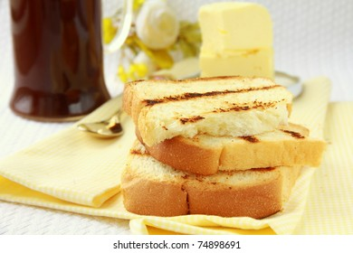 Toast with butter and a cup of black coffee for breakfast