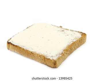 toast with butter isolated on white background