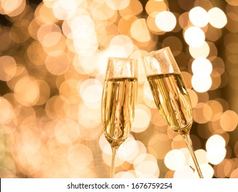 Toast with champagne against the background of Christmas illuminations.