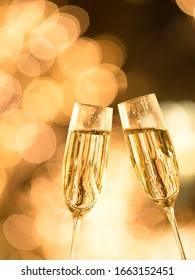 Toast with champagne against illuminations background.