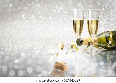 Toast champagne New Year, silver background flutes