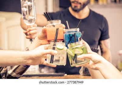 toast with cocktails glasses. concept about night life, alcohol, friendship, bartending, fun , and people