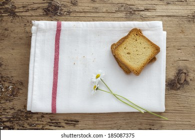 Toast and Daisy Flower on Wooden background. Rustic