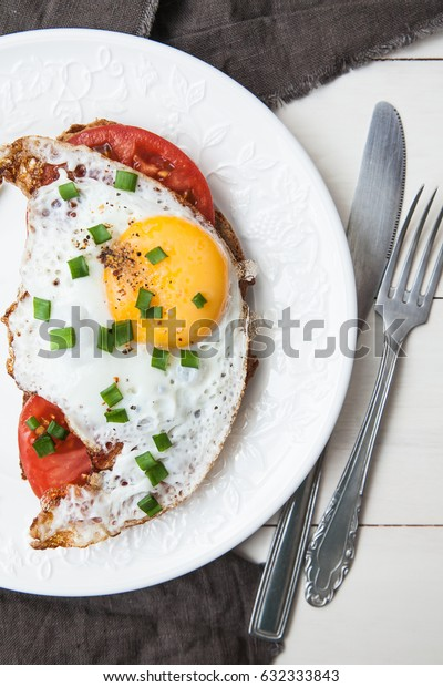 Toast with fried eggs. Breakfast.