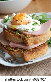 Toast with ham, mustard and poached egg