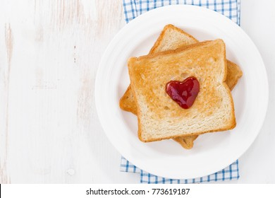 toast with jam in the shape of a heart for Valentine's Day, top view, horizontal
