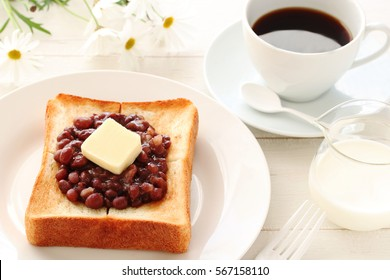 Toast with Japanese Adzuki bean paste and Butter on white plate