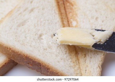 Toast and knife with butter