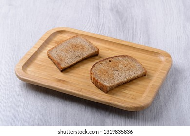 toast on a wooden plate