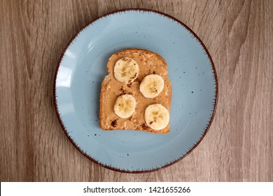 Toast with peanut butter, banana and cinnamon. Top view.
