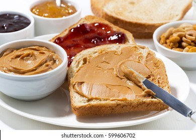toast with peanut butter and jam for breakfast, horizontal