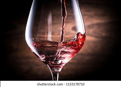 A toast with red wine