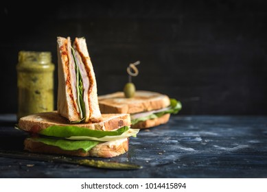 Toast sandwich with ham sliced on wooden background with blank space,selective focus