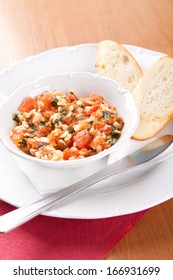 Toast spread with tomatoes, grated cheese and celer