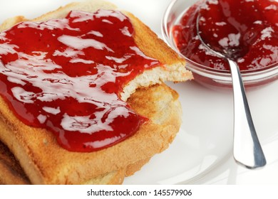 Toast with strawberry jam on a plate