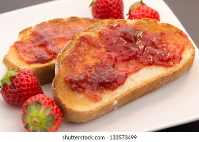 Toast with strawberry jam and strawberries