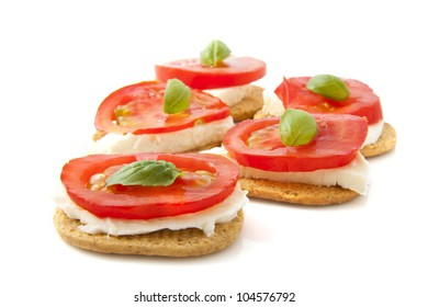 Toast with tomato cheese and basil isolated over white