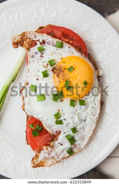 Toast with tomato and egg. Breakfast.
