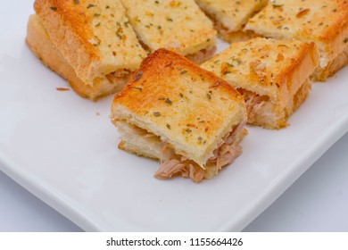 Toast tuna sandwich cut by square shape with white plate on isolated
