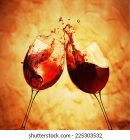 Toast with two glasses of red wine