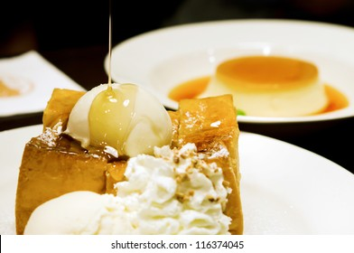 toast with whipping cream ,  ice cream  and honey syrup