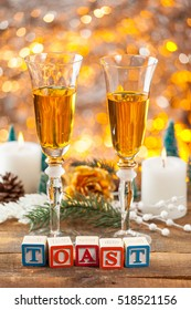 Toast Written With Toy Blocks On Christmas Card Vertical Background With Champagne And Copy Space.