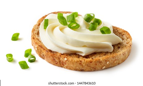 toasted bread with cream cheese and green onions isolated on white background