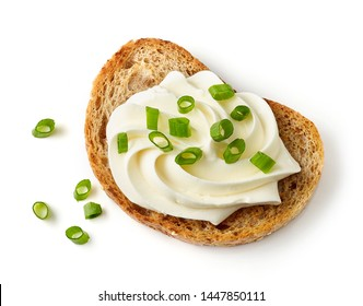 toasted bread with cream cheese and green onions isolated on white background, top view
