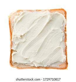 toasted bread with cream cheese isolated on white background, top view