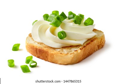 toasted bread with cream cheese and spring onions isolated on white background
