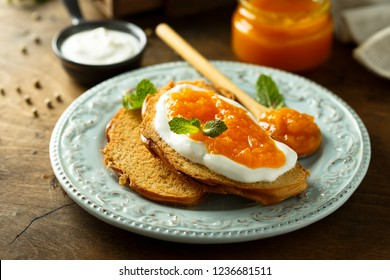 Toasted bread with fresh cheese and marmalade